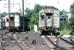 Metro North Railroad (former New Haven) railroad yard location displaying various old washboard 4400 series electric MU cars in storage at Stamford, Connecticut, August 1982