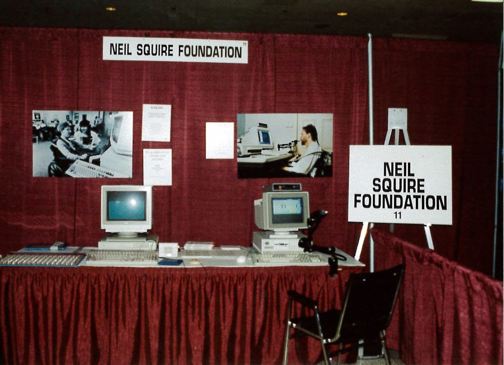 Kiosk containing Neil Squire Foundation pictures and computer hardware.