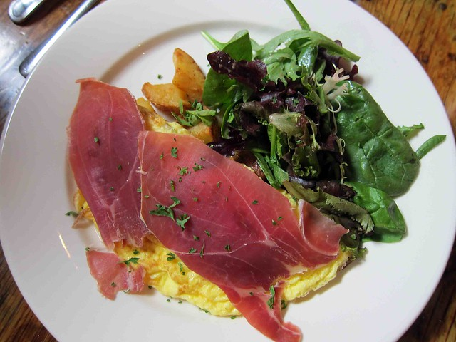 truffled eggs served with truffle oil & shaved prosciutto