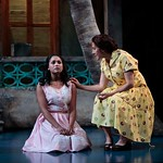 Flora (played by Monica Raymund) receives advice about love and marriage from her mother Dona Milla (played by Socorro Santiago) in the Huntington Theatre Company's production of <i>Boleros for the Disenchanted</i> by José Rivera at the South End/Calderwood Pavilion at the BCA. Part of the 2008-2009 season. Photo: T. Charles Erickson