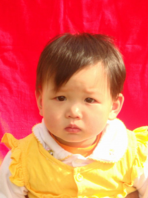 Xin Yong Li passport photo