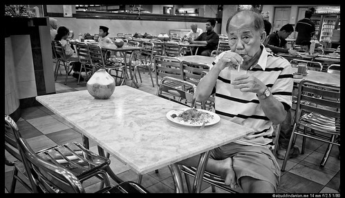 Chinese man with Indian curry