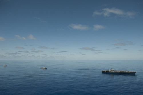 USS Carl Vinson , USS Halsey, and USS Bunker Hill transit the Pacific Ocean.