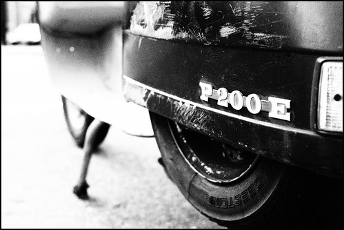 An old and worn Vespa P200E by Eric Flexyourhead