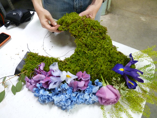 Artist Nicole Dextras assembles the bodice of one her pieces for BBG's Spring Gala and After Party. Photo by April Greene.