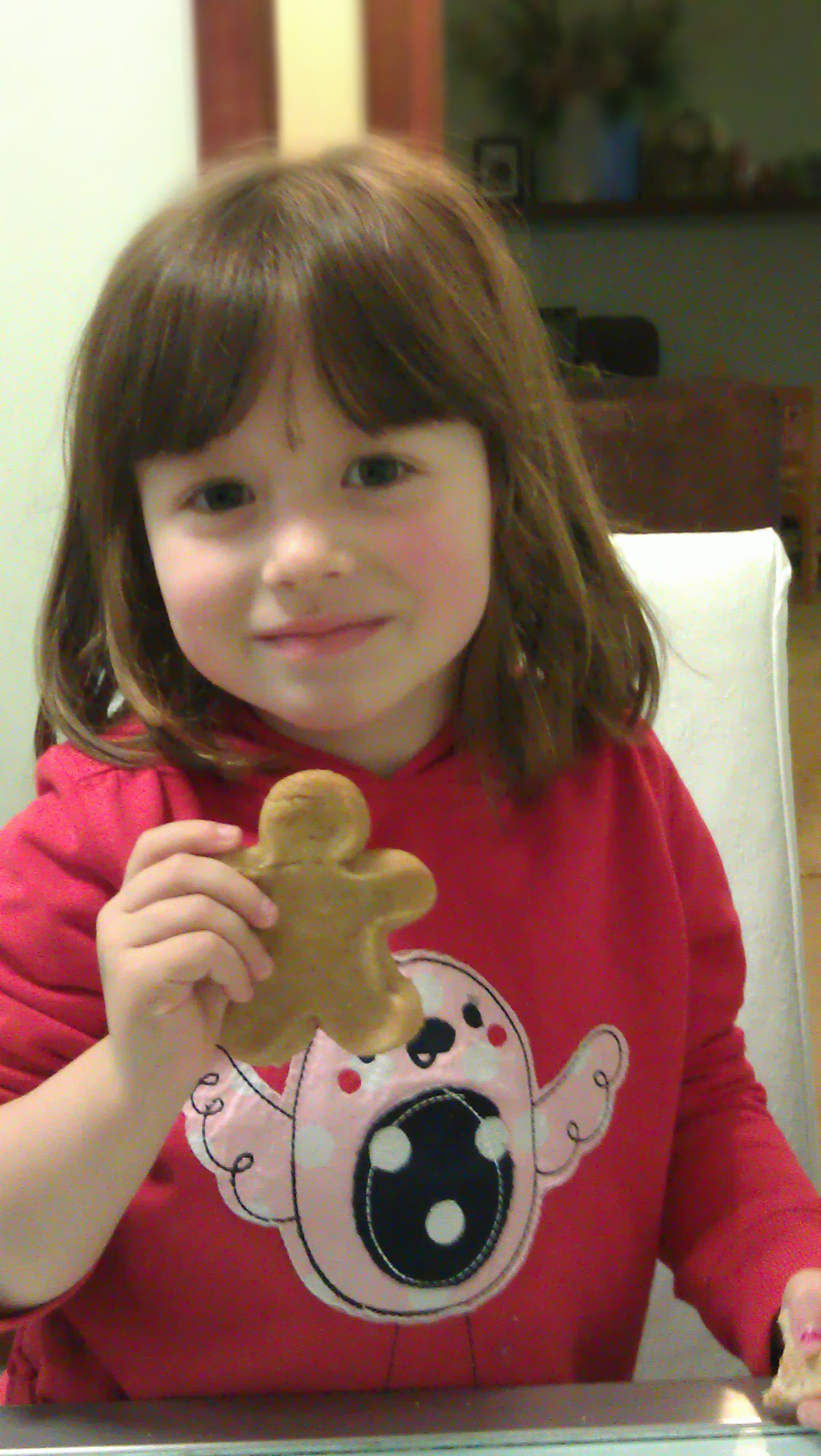 Proudly showing one of her gingerbread men...