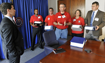CWAers presented more than 130,000 petitions from consumers and workers about the deal to FCC officials.
