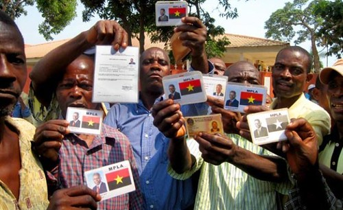 Angolan veteran soldiers flashing their MPLA membership cards during a demonstration demanding compensation for military service. Angola has been the focus of substantial economic investment in recent years. by Pan-African News Wire File Photos