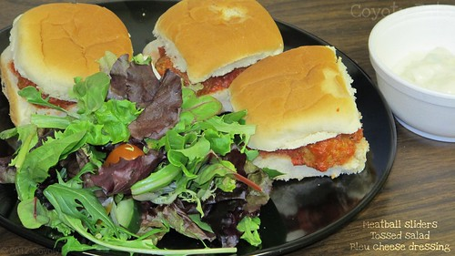 Meatball sliders and tossed salad by Coyoty
