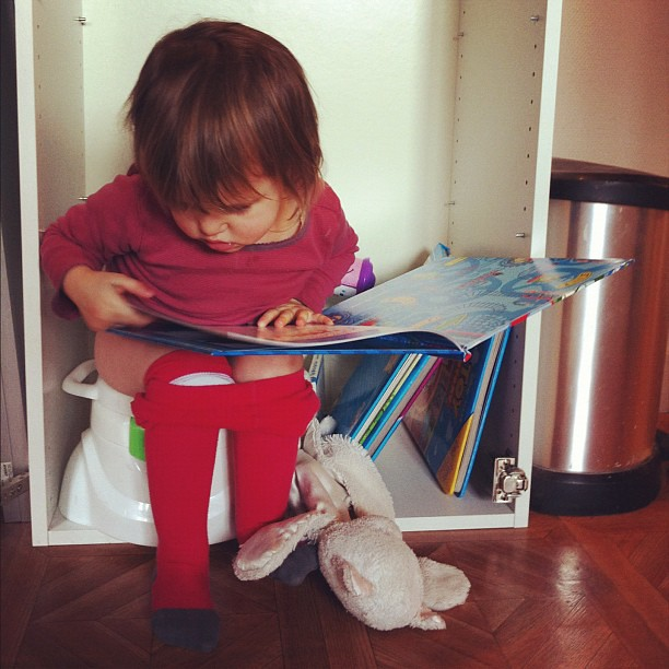 Left over Ikea cabinet = Alixe's own personal bathroom. We start naps w/out diapers this weekend. During the day stuff she down like a little pro.