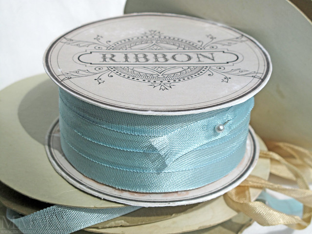 ribbon spool box with secret compartment