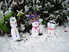 Snow people frolicking in the snow