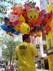 carnival(0.0), mascot(0.0), chinese new year(0.0), yellow(1.0), balloon(1.0), toy(1.0),