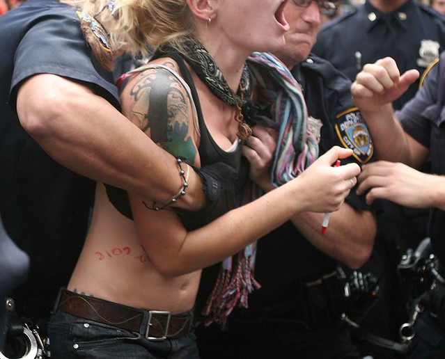 Cop groping torturing woman Occupy-Wall-Street