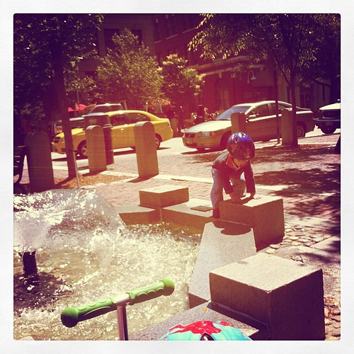 Playing at the water fountain