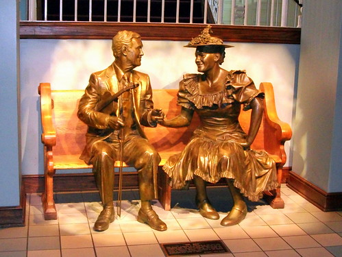 Roy Acuff & Minnie Pearl share a Ryman Auditorium Bench