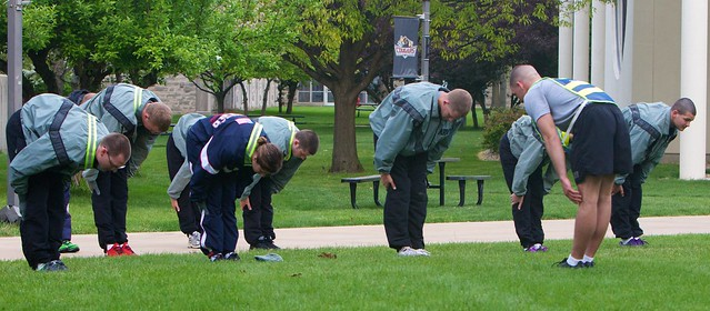 The IU Kokomo ROTC Corps of Cadets warms up before physical training Thursday, April 5, on campus..