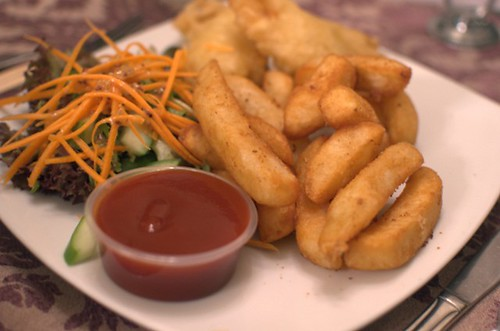 Beer battered fish with chips and salad