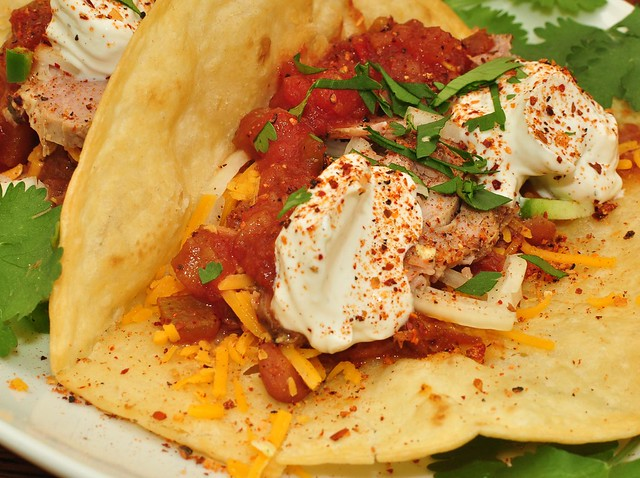 Mmm... tacos with beans, cheese, roast pork and sour cream