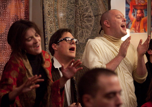 Harry, Paul, and Lakshmi chanting at the Hare Krishna gathering