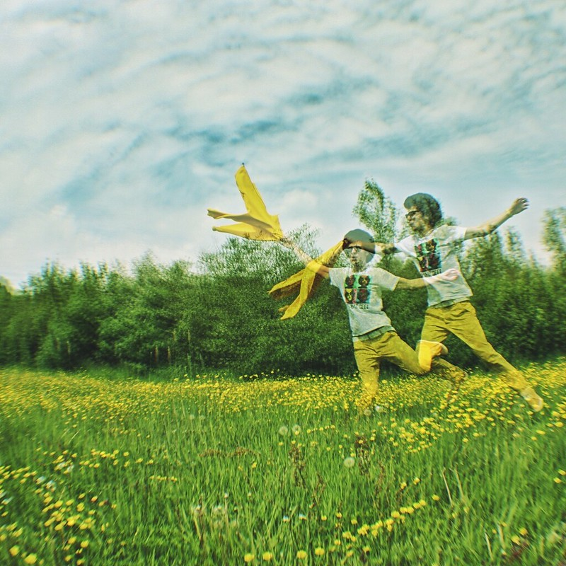 double exposure jump happy fun spring bright colours contrast photography guy jump jumping man  green yellow