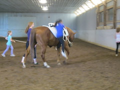 Olivia Dismounting from Horse