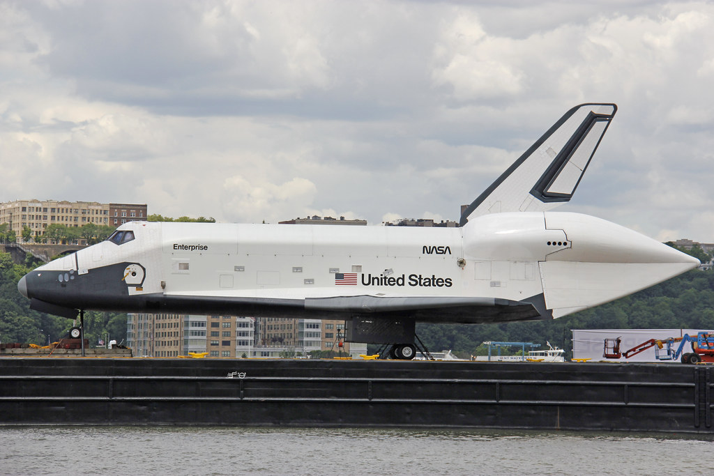 Picture Of The Space Shuttle Enterprise Sitting On A Barge In The Middle Of The Hudson River In New York City Before Being Loaded Onto The Flight Deck Of The USS Intrepid. Photo taken Wednesday June 6