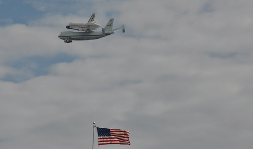 Space shuttle Discovery over U.S. Capitol