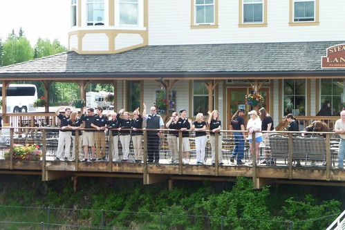 Crew at Steamboat Landing waving to us on the Riverboat Discovery