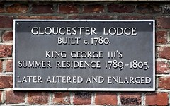 Photo of George III and Gloucester Lodge black plaque