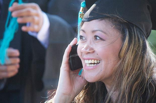 <p>A joyous Honolulu CC graduate</p>