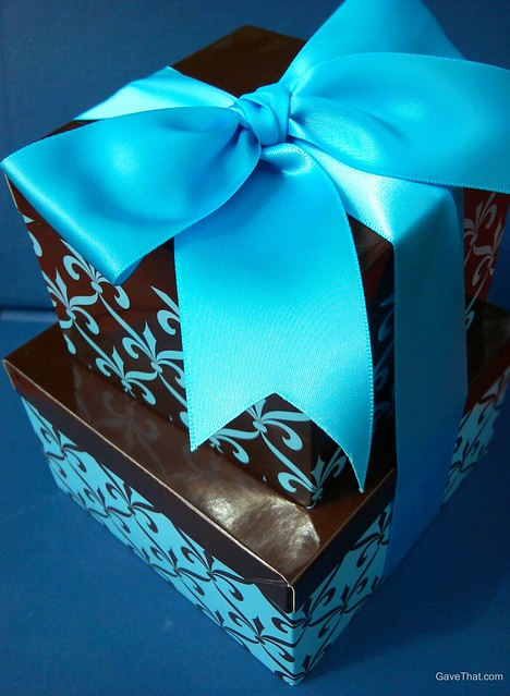 Lovely blue and brown gift box tower by Gift Accept filled with cookies