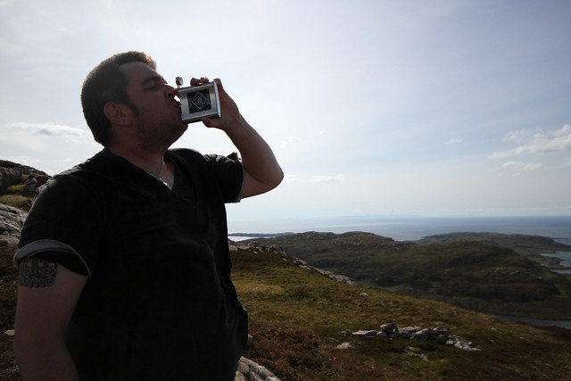 Egor takin a dram on top of Meall an Fheadain