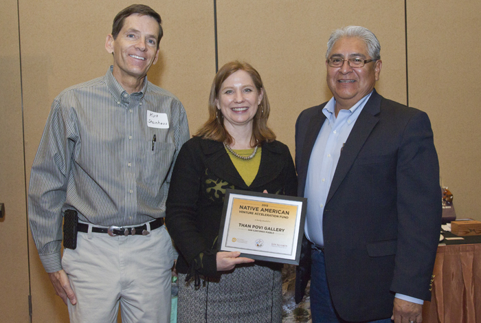 Elmer Torres (r) recently participated in a podcast on Native American entrepreneurs. Here, Torres receives a Native American Venture Acceleration Fund award from Kurt Steinhaus (l), director of the Laboratory's Community Programs Office, and Kathy Keith (m), executive director of the Regional Development Corporation.
