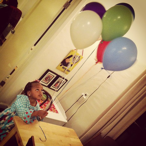 a girl and her balloons