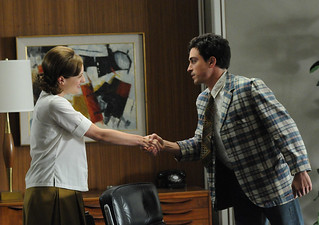 Peggy shaking hands with Michael, one of the new employees