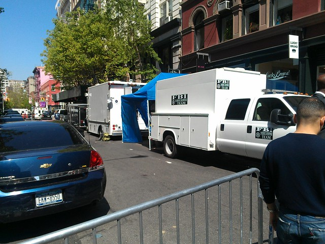 FBI Evidence Response Team vehicles and tent at Prince and Wooster
