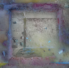 More Polaroids seen through a hole in the floor.