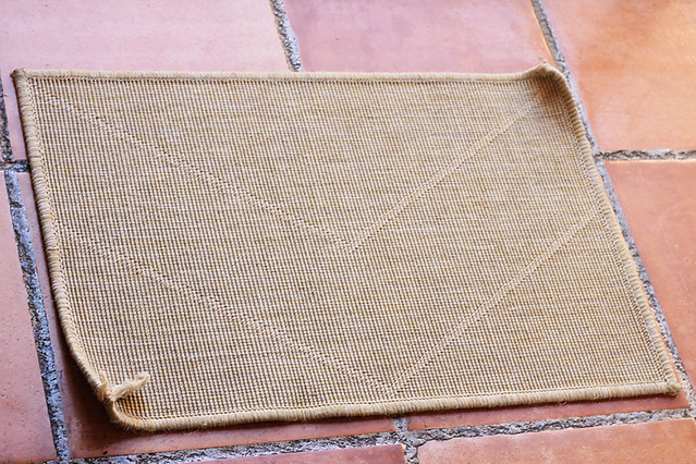 Otherwise fine IKEA doormat with curling, fraying edges
