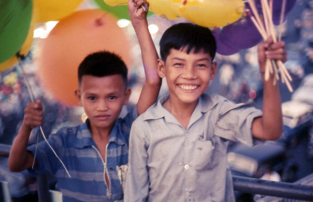 Saigon 1969 - Boy balloon sellers on pedestrian bridge at Central Market