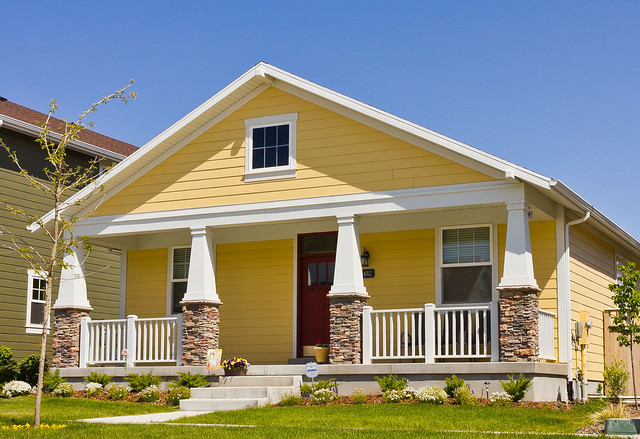 Modern yellow bungalow house built in 2010 this har for Craftsman house plans utah