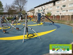 Poured in place rubber wet pour play area safety surfaces installation.jpg;