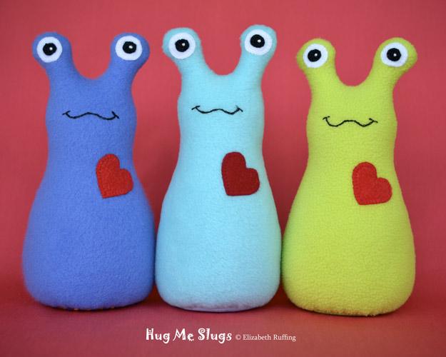 Cobalt blue, Light Turquoise, and Bright Light Green Hug Me Slugs, original art toys by Elizabeth Ruffing