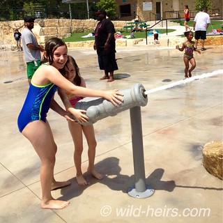 McKinley and Cordelia man the water cannon at Quarry Splash Pad in Leander, TX