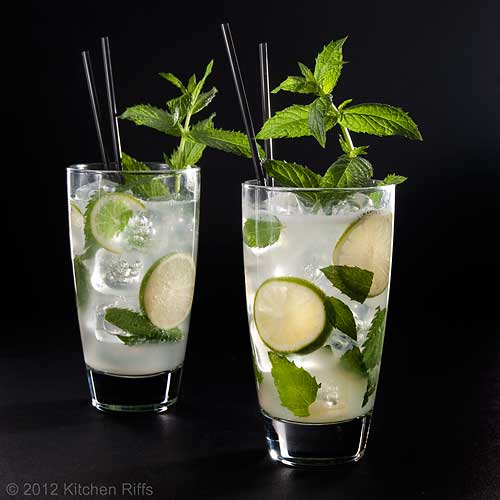 Two Mojito Cocktails with Mint Garnish and Straws, Black Background
