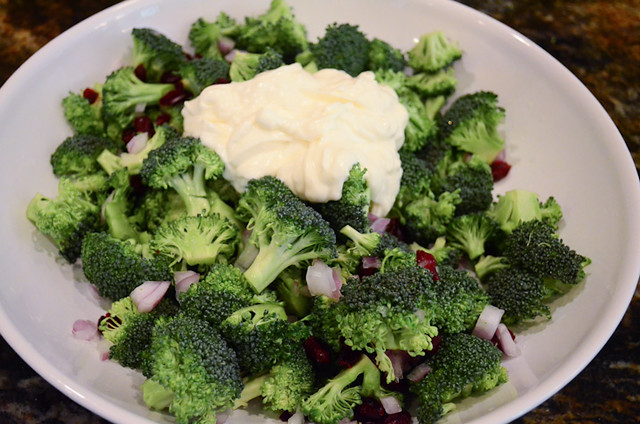 The dressing is added to the Broccoli Salad mixture.