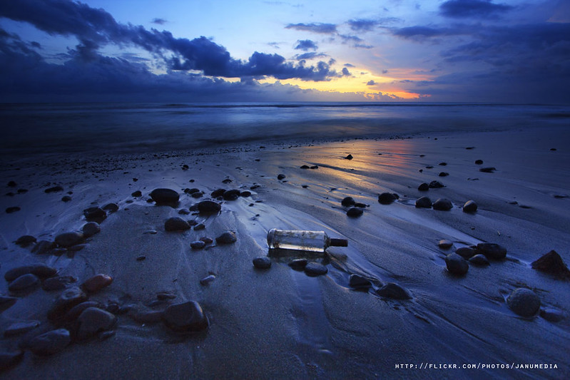 bali landscape image : Lonely bottle at Yeh Gangga Beach