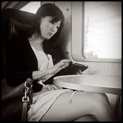 iPad communicator. #strangersintransit #commuteroftheday #sneakycommutershot #candid #portrait #asian #woman #legs #ipad #style #train #inkstagram #iphonesia #iphoneography #statigram #igerssweden #igersmalmö
