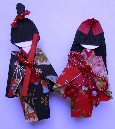 Origami paper dolls