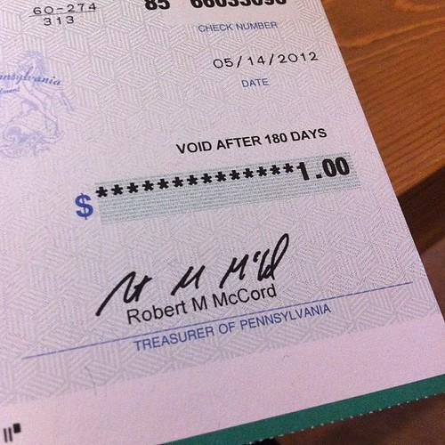 Pennsylvania income tax refund check worth $1.00.